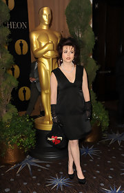 Helena looked glamorous in a simple little black dress and pearls at the Academy Awards luncheon.