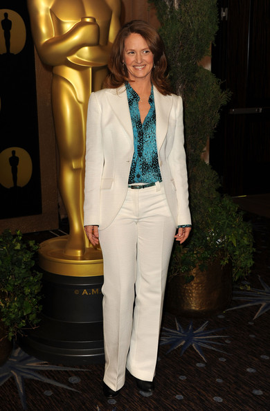 Melissa went for a sophisticated ensemble in a white pant suit over a printed turquoise blouse.