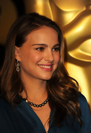 Actress Natalie Portman highlighted her glowing look with diamond slice earrings.