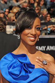 TV host Shaun Robinson paired her ruffled gown with a crystal cocktail ring.