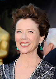 Annette Bening stepped up her look with emerald green dangle earrings.