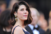 Marisa Tomei amped up her look with decadent multi-hued gemstone earrings.