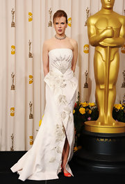 Nicole Kidman added a dose of color to her ivory Oscar dress with orange Pierre Hardy peep toes.