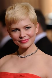 Michelle Williams attended the 84th Annual Academy Awards wearing a vibrant pink lipstick with a soft satin finish.
