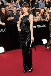 Rose shined in a black sequined detailed gown that showed off her statuesque figure.