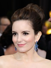 Tina Fey wore her hair in a voluminous bun at the 84th Annual Academy Awards.