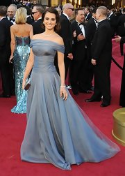 Penelope was a vision in a periwinkle off-the-shoulder gown with ruched detailing.