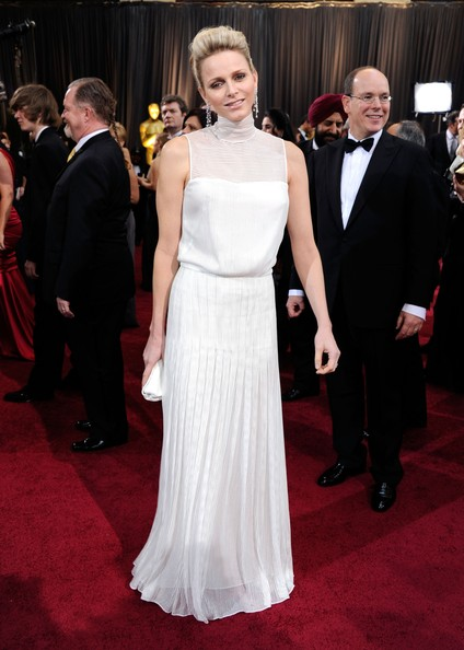 Charlene Wittstock, the Princess of Monaco, hid her willowy figure in a loose-fitting white gown.