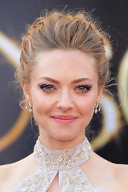 Amanda Seyfried brought out the green in her eyes with a swipe of purple shadow.