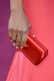 Kerry Washington played up the breathtaking coral hue of her Miu Miu gown with a deeper coral satin clutch.
