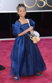 As the youngest Oscar nominee, Quvenzhane Wallis glammed it up in a royal blue custom gown and matching stole.