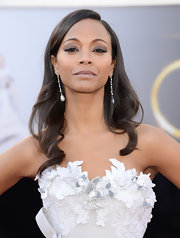 Zoe Saldana — and her tumbling curls — exuded confidence at the 2013 Oscars.