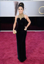 Salma Hayek showed off her petite frame at the Oscars with a blue velvet gown with a gold embellished neckline.