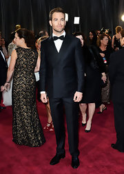 Chris Pine looked sleek and sophisticated in a double breasted tuxedo and bow tie at the 2013 Oscars.