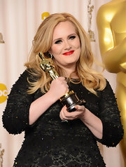 Halfway through her Oscars performance Adele switched up her look with siren red lips.
