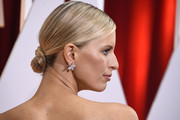 Karolina Kurkova slicked her hair back into a twisted bun for the Oscars.