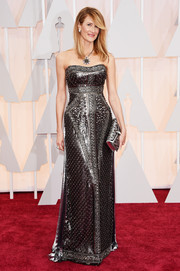 Laura Dern went for edgy glamour at the Oscars in a richly textured gunmetal strapless gown by Alberta Ferretti.
