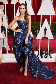 Louise Roe opted for a structured watercolor-print strapless gown by Monique Lhuillier for her Oscars red carpet look.