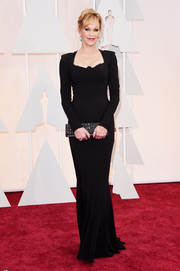 Melanie Griffith flaunted her ageless figure in a curve-hugging black gown during the Oscars.