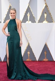 Rachel McAdams ravished at the Oscars in a high-slit dark-emerald halter gown by August Getty.