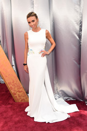 Giuliana Rancic attended the Oscars wearing a simple yet sweet Georges Chakra gown with a floral-embellished waist and a long train.