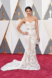 Priyanka Chopra went for sultry glamour in a sheer white strapless gown by Zuhair Murad at the Oscars.