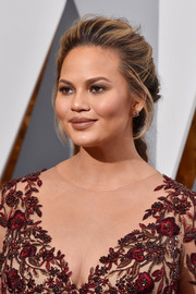 Chrissy Teigen wore her hair in a romantic loose braid during the Oscars.