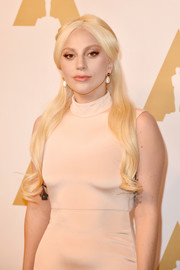 Lady Gaga looked like a doll with her flawlessly styled half-up 'do at the Academy Awards nominee luncheon.