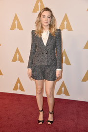 Saoirse Ronan teamed her suit with black knot-detail peep-toe heels by Alexandre Birman.