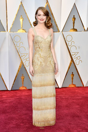 Emma Stone channeled the '20s with this fringed and embroidered gold gown by Givenchy Couture at the 2017 Oscars.