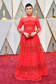 Ginnifer Goodwin went conservative and sweet in a high-neck, lace-panel red gown by Zuhair Murad for her 2017 Oscars look.