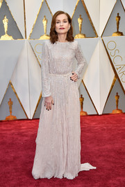 Isabelle Huppert went for subtle sparkle in a long-sleeve nude Armani Privé gown with silver beading at the 2017 Oscars.