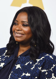 Octavia Spencer wore her hair down to her shoulders in corkscrew curls at the Academy Awards nominees luncheon.