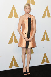 Michelle Williams was sweet and mod in a peach and black one-shoulder A-line dress by Louis Vuitton at the Academy Awards nominees luncheon.