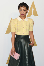 Ruth Negga accessorized with a quilted pink clutch by Miu Miu when she attended the Academy Awards nominees luncheon.