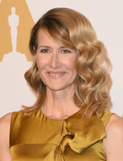Laura Dern was fabulously coiffed with voluminous curls and side-swept bangs at the Academy Awards nominees luncheon.