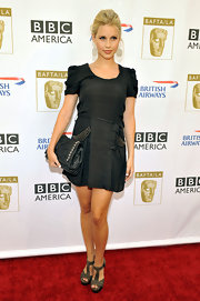 Claire Holt chose a gray dress with funky studded pockets and ruched shoulders for her edgy red carpet look.