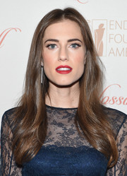 Allison Williams attended the Blossom Ball wearing her long hair down with a center part and just a hint of a wave down the ends.