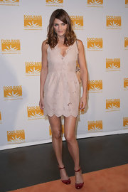 "Helena sported the nude spring trend with a girlie ""Mai Lace"" mini dress."