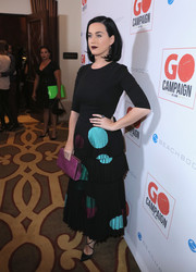 Katy Perry looked uncharacteristically tame at the GO Campaign Gala in an Ulyana Sergeenko Couture dress featuring a fitted bodice and a tiered, circle-print skirt.