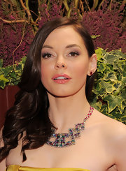 Rose McGowan added a shimmering touch to her look with metallic shadow in a pearly white hue. She added drama by working a lilac purple into her creases.