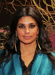 Rachel Roy added a gilded touch to her look with long slender gold earrings.