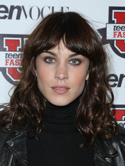 Alexa Chung rocked a '70s vibe with her curly 'do and center-parted bangs at the Teen Vogue University.