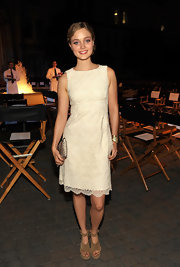Bella Heathcote chose a python purse to style her Teen Vogue party look.