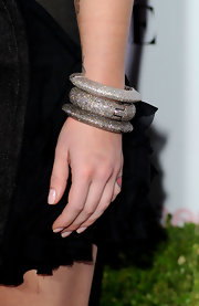 Kelly added some major bling to her look with sparkling bangle bracelets.