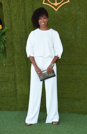 Regina King punctuated her white look with a metallic silver clutch.