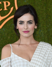 Camilla Belle styled her hair into a loose updo for the Veuve Clicquot Polo Classic.