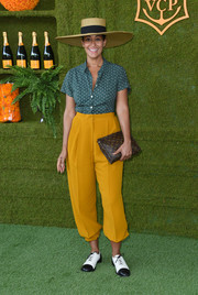 Tracee Ellis Ross donned a dotted teal shirt by Agnes B. for the Veuve Clicquot Polo Classic.