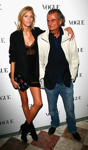 Anja Rubik accessorized with a fun-looking star-embellished clutch at the 90 years of Vogue covers celebration.