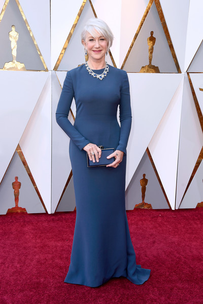 Helen Mirren went for understated elegance in a long-sleeve blue column dress by Reem Acra at the 2018 Oscars.